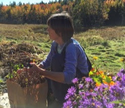Heather McCargo holding some native wildflowers